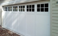 Custom paneled garage door white with windows