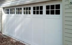 Custom paneled garage door white with windows