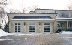 Custom garage door that look like home windows