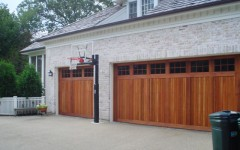 Custom built dould wide overhead garage doors - wood with windows