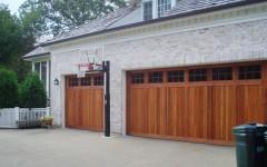 Custom built dould wide overhead garage doors - wood with windows