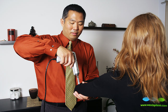 Chiropractice care with Dr. Wilson Park with Impulse IQ Adjusting Instrument