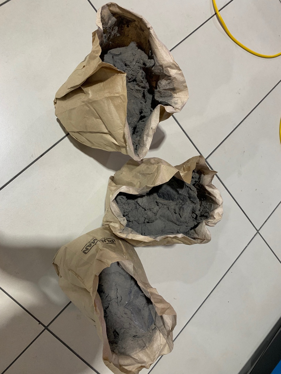 These are the dust bags from 3 vacuum cleaners  And Below - The Team - Aaron, myself, Mike, Wellington and Lee