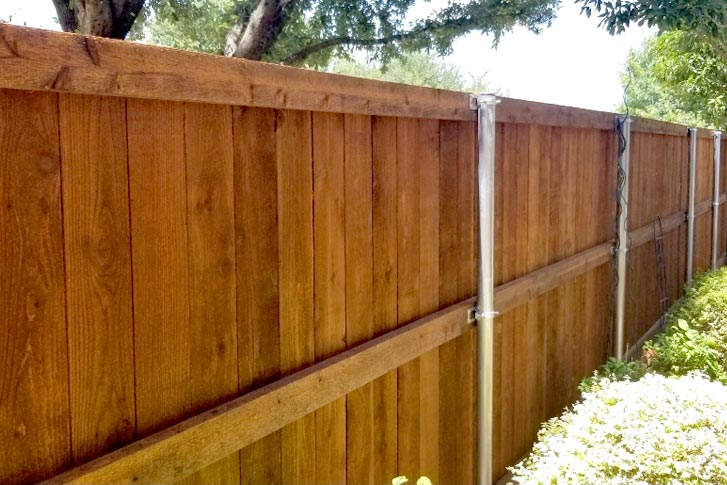 North Dallas new residential fence poles after repairs Roofing Ontop & Exteriors