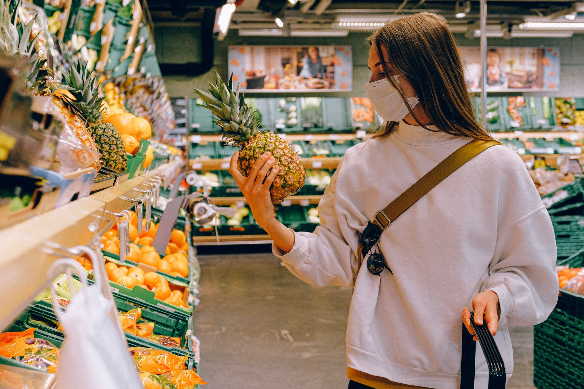 girl shopping fresh fruits from departmental store