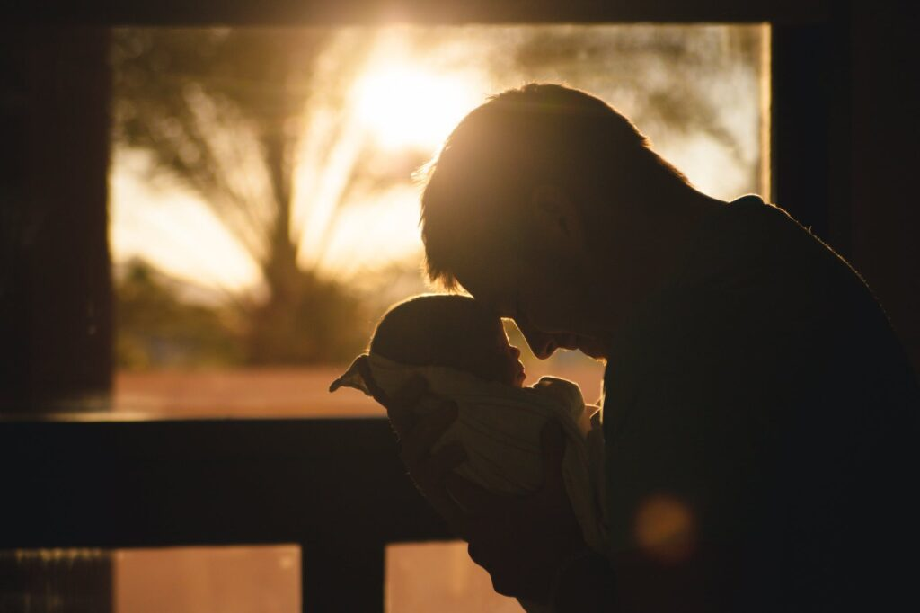 father holding baby in his hands