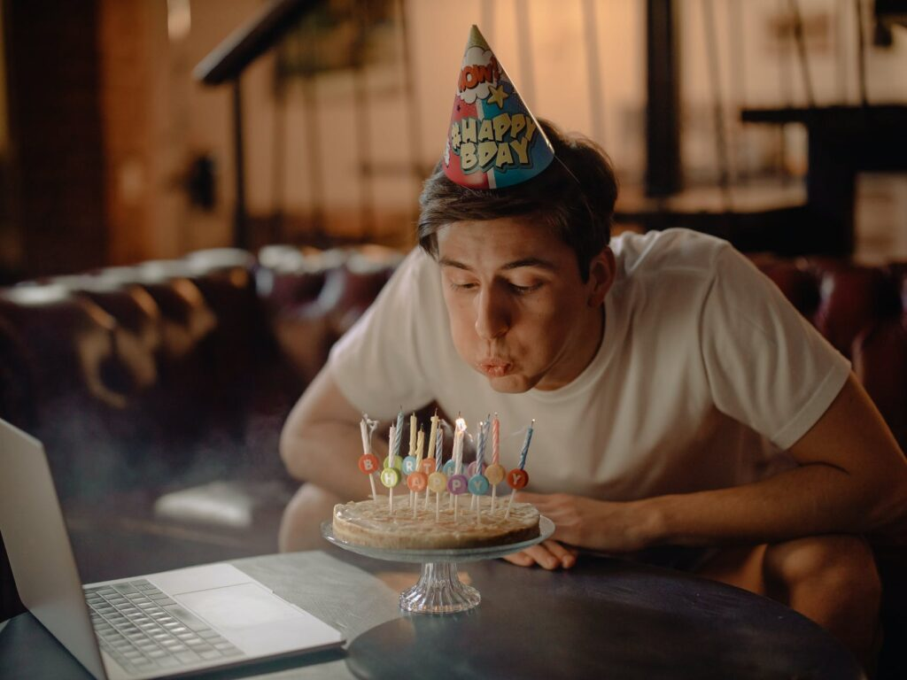 a boy blowing birthday candles in lockdown