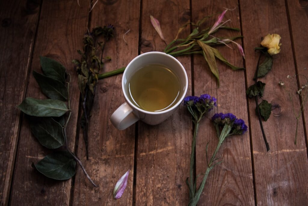 A cup of green tea with natural tea leaves