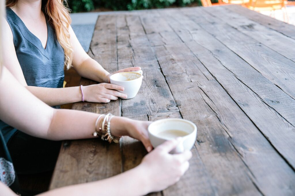 ladies discussing work plans over a cup of coffee