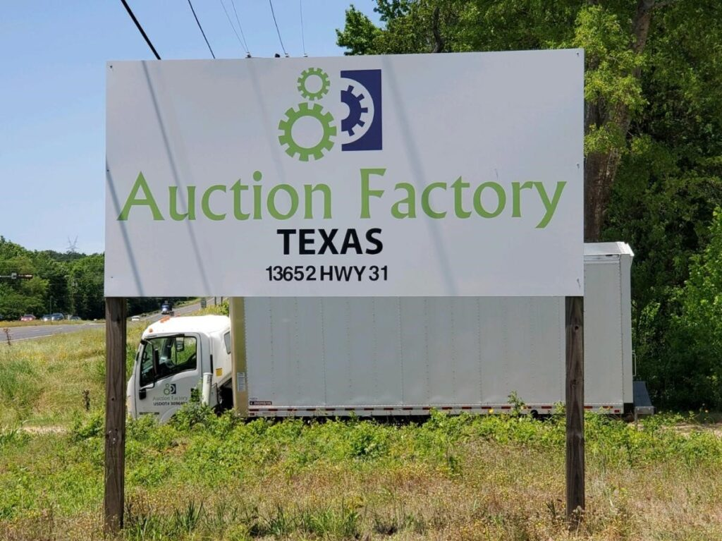 Auction Factory Texas road sign