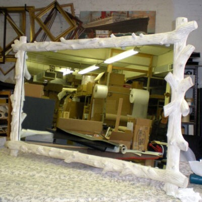 Handcarved twig mirror frame.