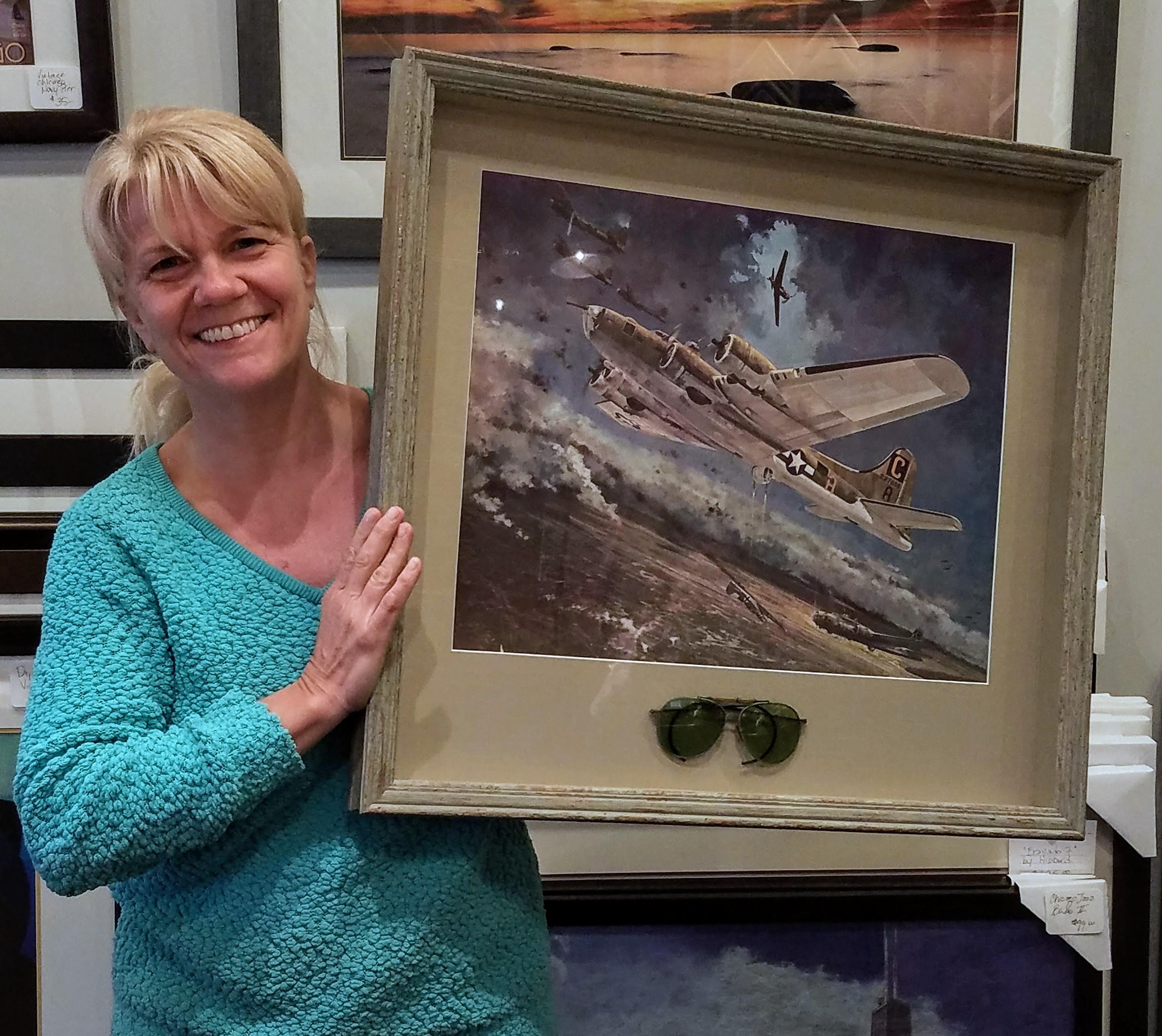 Roseann holding her custom framed art