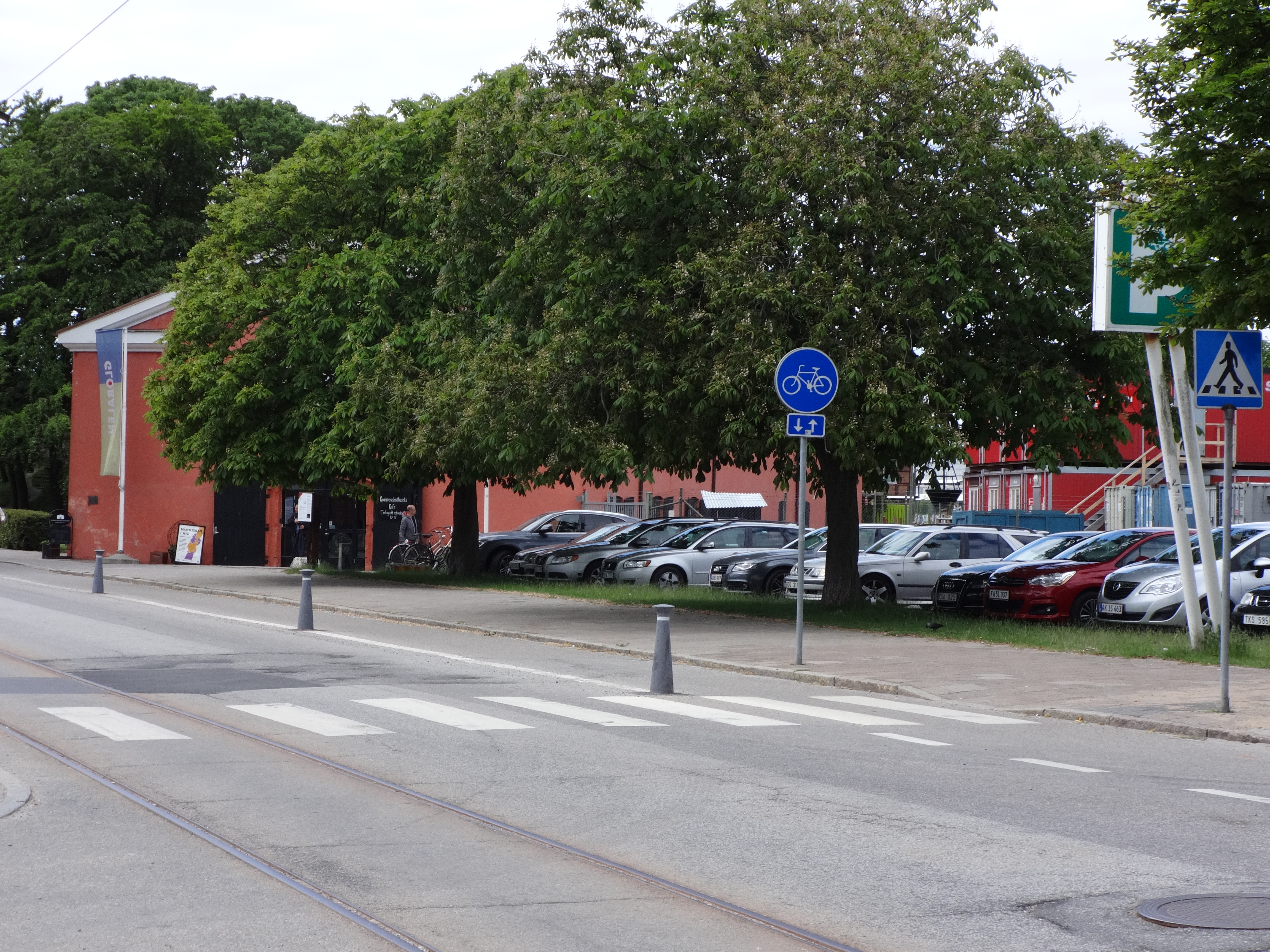 A street in Sweden. Note the sign marking how bikes and pedestrians share the sidewalk.
