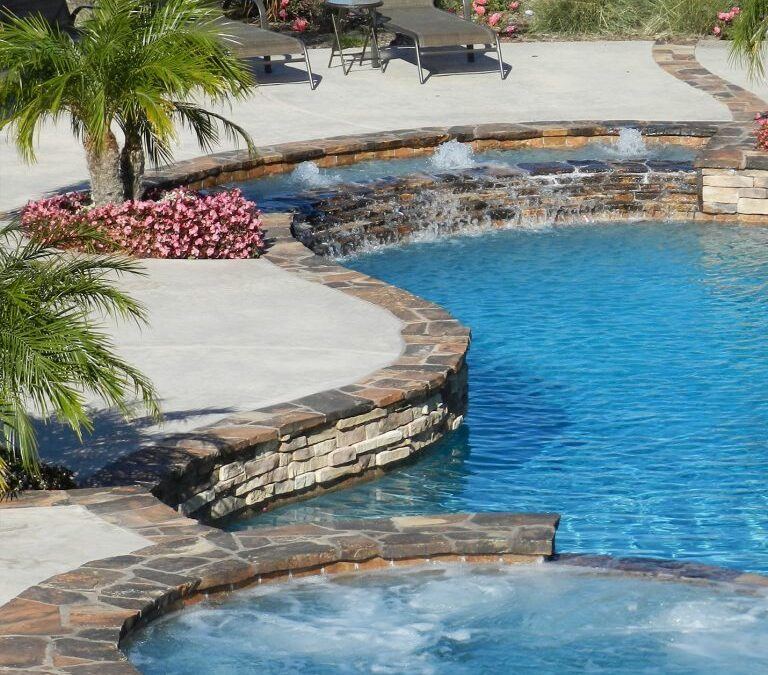 What are the Pros and Cons of using Quartzite (generically called flagstone) coping around a pool?