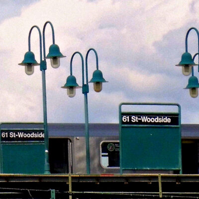 This is an image of a 61st St Woodside Subway Station Sign