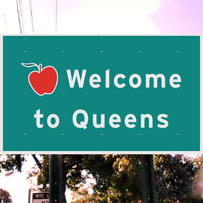 This is an image of a Welcome to Queens Road Sign