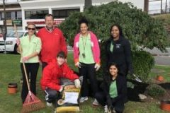 Paramount PT staff participating in PT Day of Service by planting gardens along Sunrise Plaza