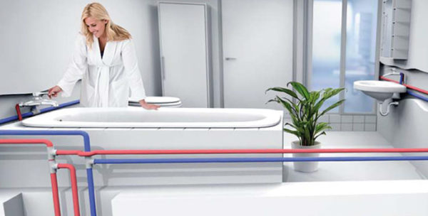 Woman smiling holding bath tub faucet in all white bathroom with water piping diagram