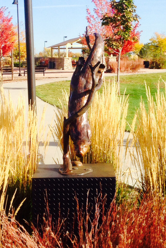 The image is of the River Otter sculpture installed in ​Quail Creek Park, Broomfield, CO.