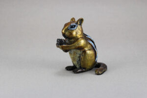 Little bronze Chipmunk eating a peanut.