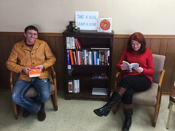 Heath Rost and Barb Peterson enjoying a good read at Rost Motor