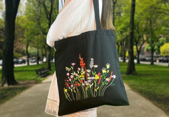 black bag with emroidered flowers