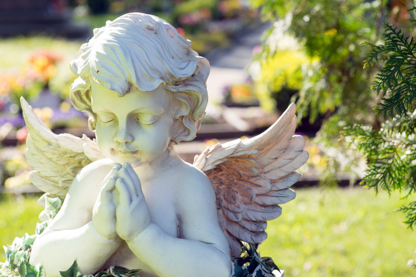 Funeral preplanning Angel figure in a cemetery