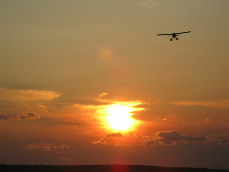 Float Plane Fly Over at Sunset