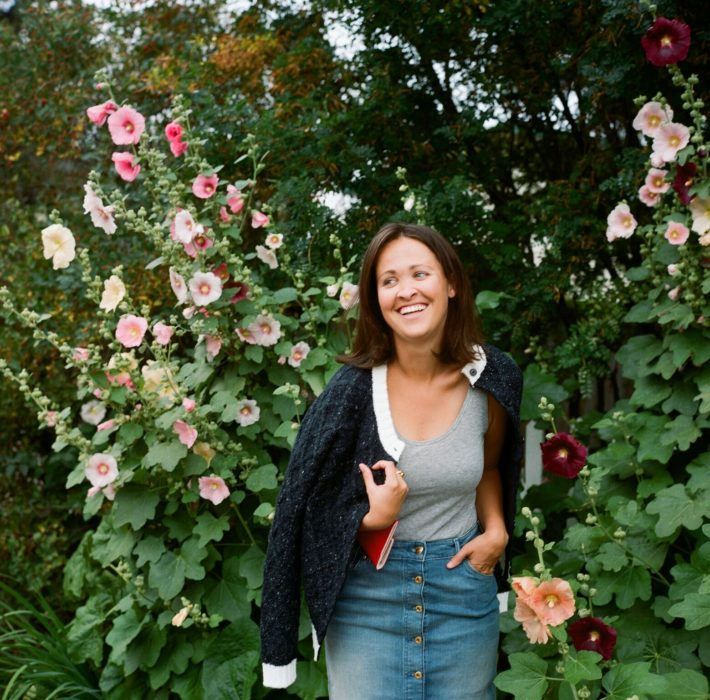 Jackson Hole blogger next to tall flowers shot on film