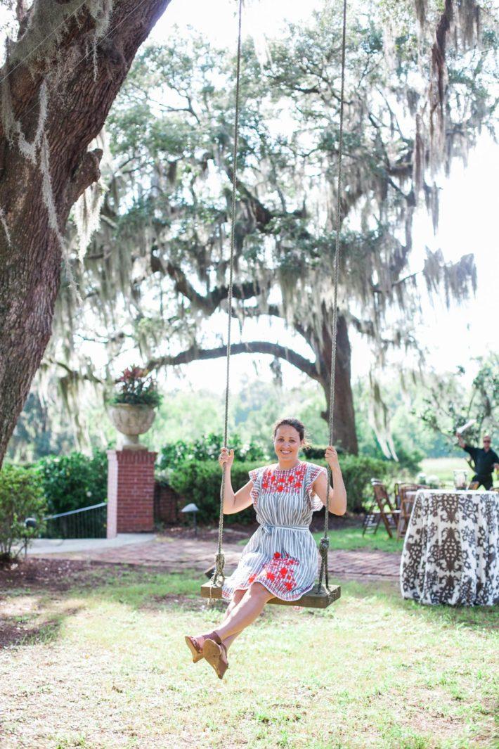 Girl on swing in Savannah Georgia wearing Kate Spade dress