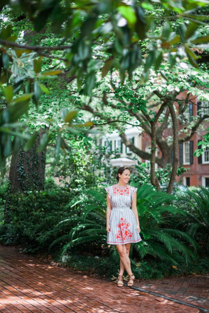 Travel blogger visits Downtown Savannah Georgia wearing Kate Spade dress