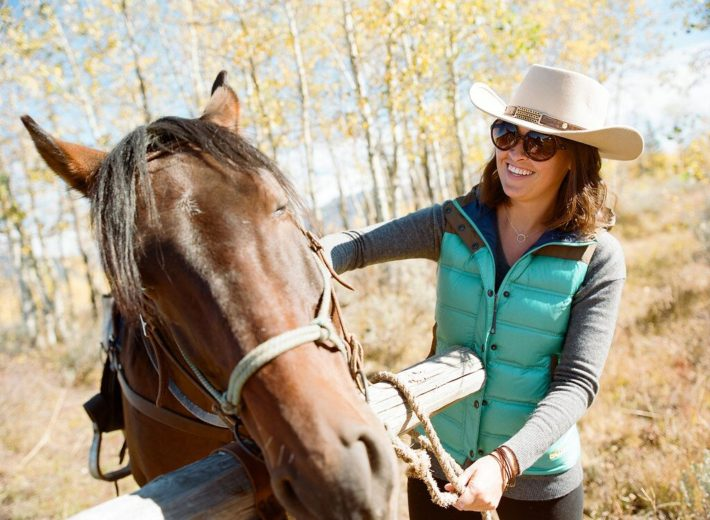Jackson Hole Blogger Meagan brushes her horse at Turpin Meadow Ranch in Grand Teton National Park