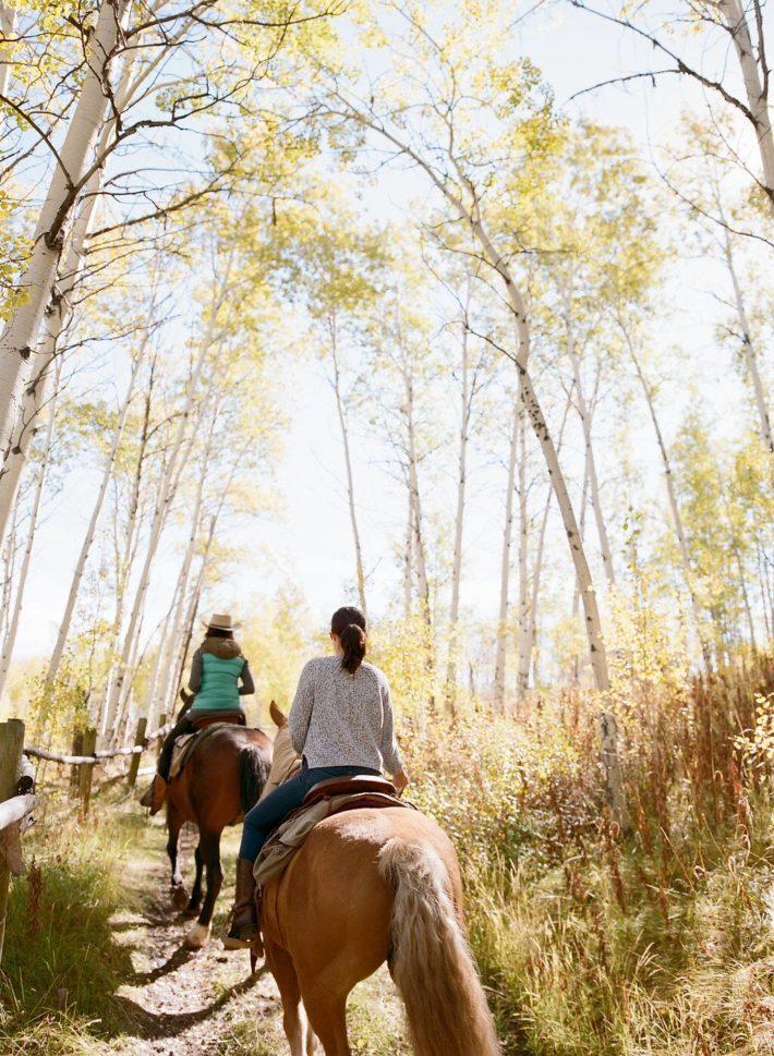 Horseback riding in Autumn Leaves of Grand Teton National Park