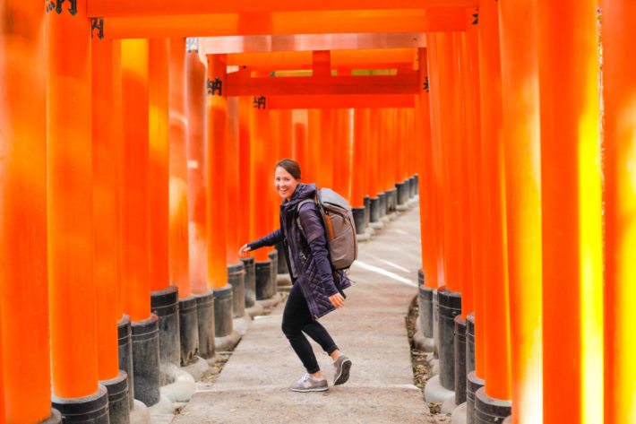 Travel Blogger at Fushimi Inari Taisha wearing Athleta Rock Springs Jacket in Kyoto Japan