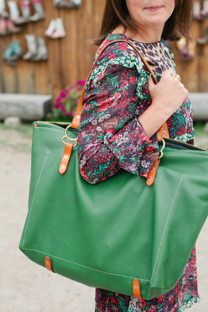 Jackson Hole Blogger at Puzzleface Ranch showcasing Western Style and a Copperdot handmade bag