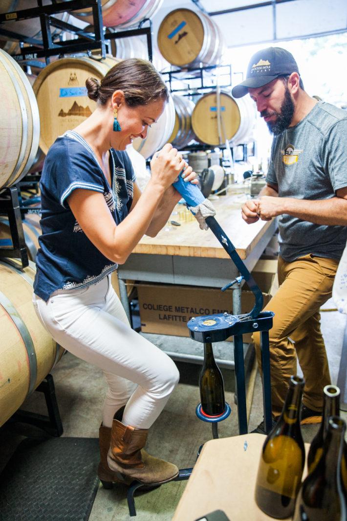 Jackson Hole Blogger at Jackson Hole Winery corking a wine bottle