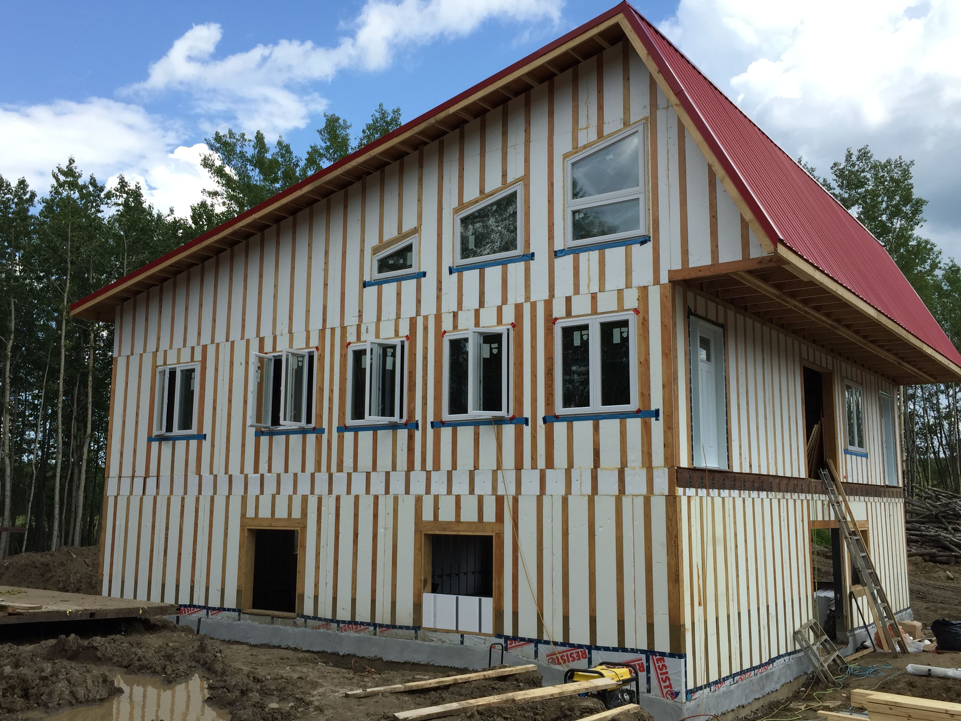 Full Summer home bungalow energy efficient building envelope pre strapped for planking siding