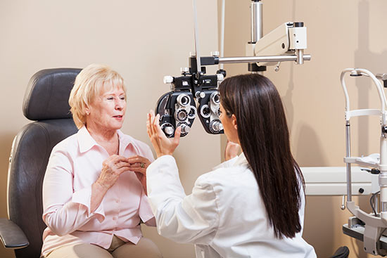 Middle aged woman getting her eyes checked at the eye doctor
