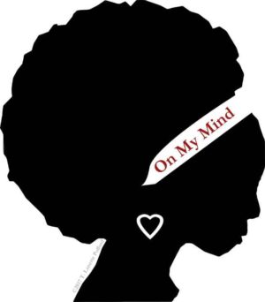 Silhouette of Black Woman with Afro and white headband that says