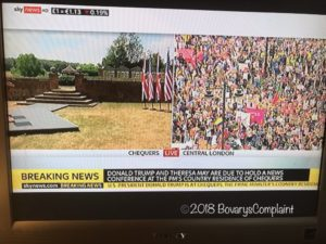 SkyNews split screen of Chequers in Buckinghamshire and protests in London, England.