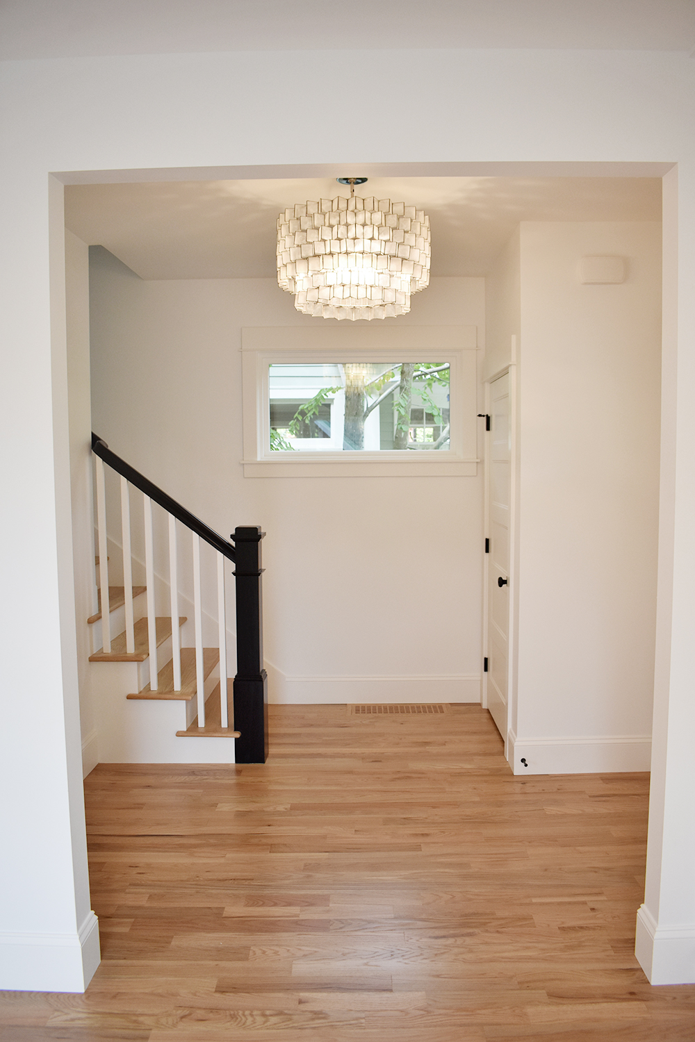 Hallway remodel with new flooring and lighting fixture