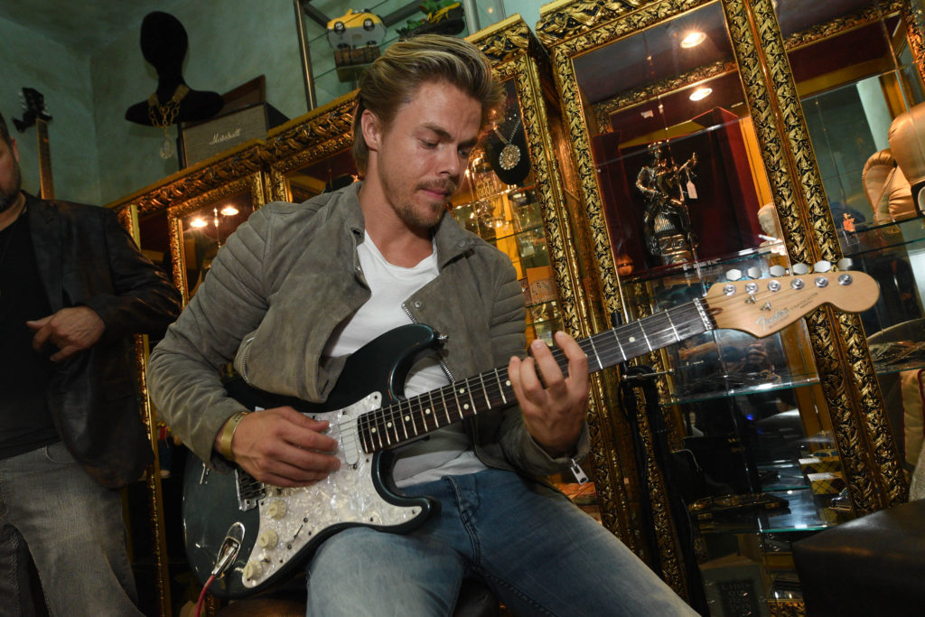 Derek Hough plays guitar at the Chris Santos and TAO Group opening of Beauty & Essex at The Cosmopolitan of Las Vegas_Al Powers