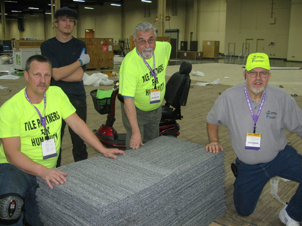 S2 Pic#74 Mark Miller, David Miller, and Augie DePhillips with River Valley Community Outreach Center and Herb Miller of Tile Partners for Humanity with Beaulieu carpet