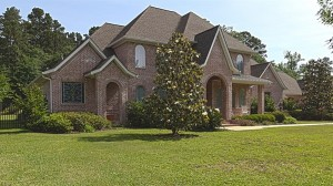 This mansion has a variety of roof pitches. It is important to find the pitch for all roof planes before an accident or a mistake becomes a reality.