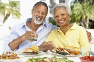 Older couple enjoying all types of food because of perfect fitting dentures