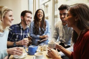 groups of friends enjoying coffee with sparkling smiles from outstanding cosmetic dental thereapy