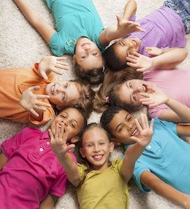 kids laying down in a circle part of the no cavities club and great preventative dental care