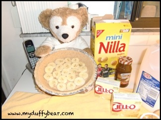 Duffy the Disney Bear shows off with a closer look of the banana arrangement in the pie crust.