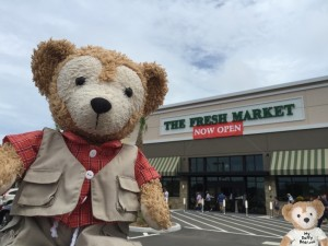 Duffy the Disney Bear in the front of The Fresh Market on Opening Day
