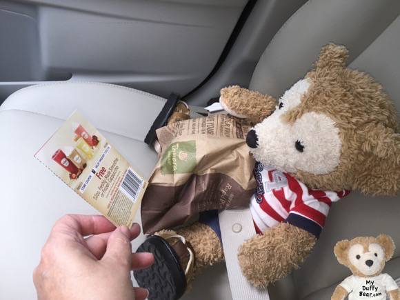 Duffy the Disney Bear gets handed a coupon for a free smoothie at the new WaWa